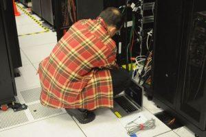 technician racking a server