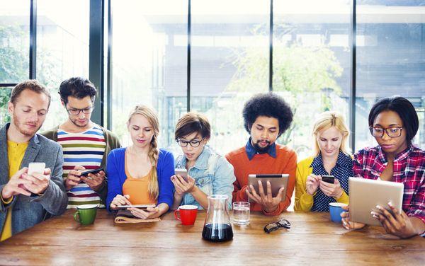 millennials looking at technology